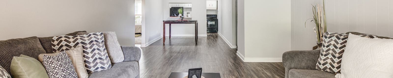 plank-style floored living room with model furnishings at Reserve at Midtown Apartments, Tallahassee, FL