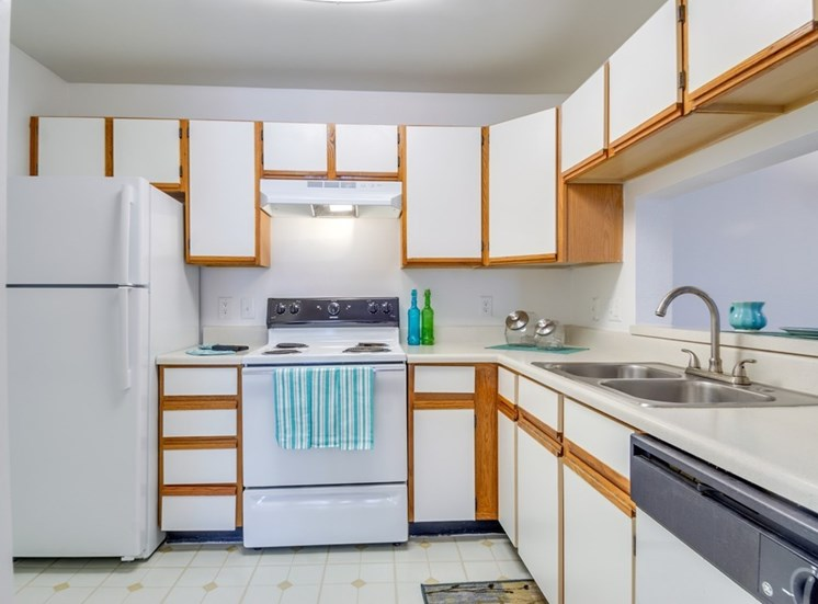 Kitchen With White Cabinetry And Appliances at Crestview Apartments, Fredericksburg