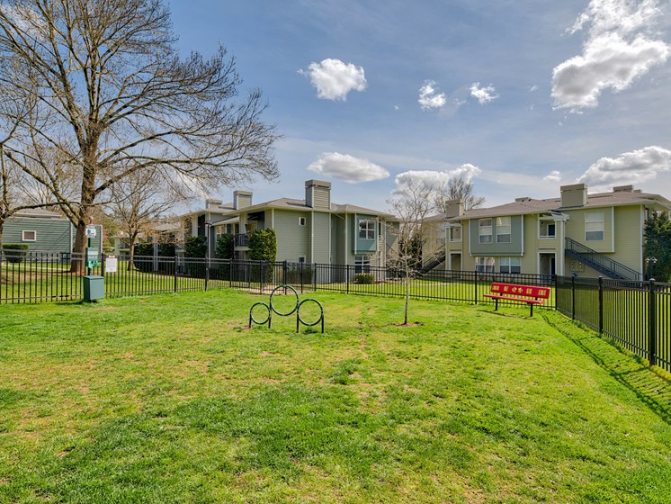 Newly Renovated Apartments in Lake Oswego OR-Kruseway Commons Gated Off-Leash Dog Park with Grass, Benches, and Doggie Bags