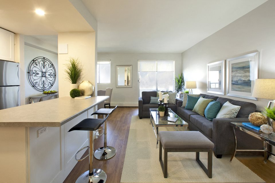 Laura Secord Apartments spacious living room with view into kitchen in Niagara Falls, ON