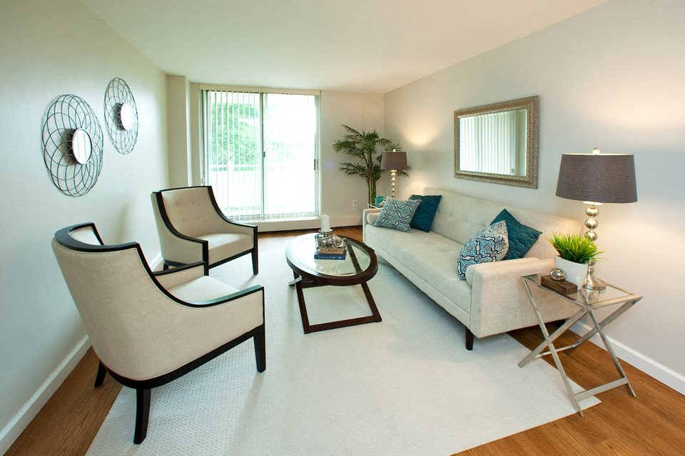 Lord Simcoe Apartments bright, spacious living room with access to balcony in