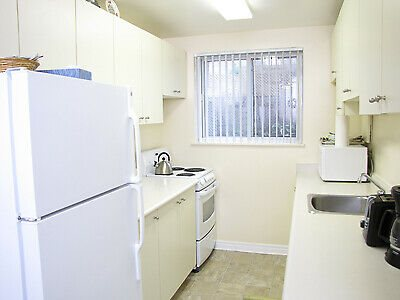 High Park Apartments kitchen with full size fridge and full range stove