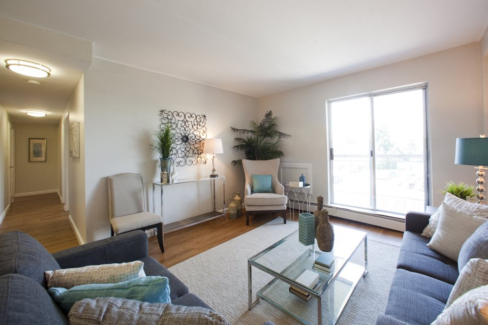 Linden Court large living room with access to balcony in St. Catharines, ON