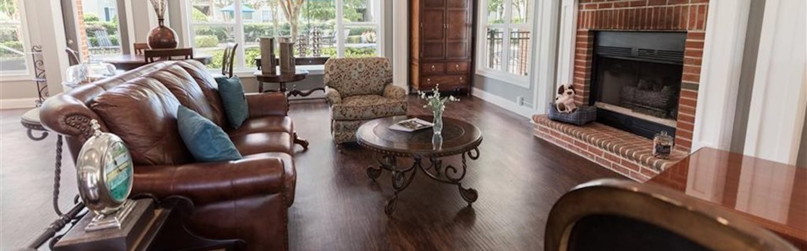 Clubhouse with comfortable seating, huge windows, and cozy fireplace at Stillwater at Grandview Cove, Simpsonville