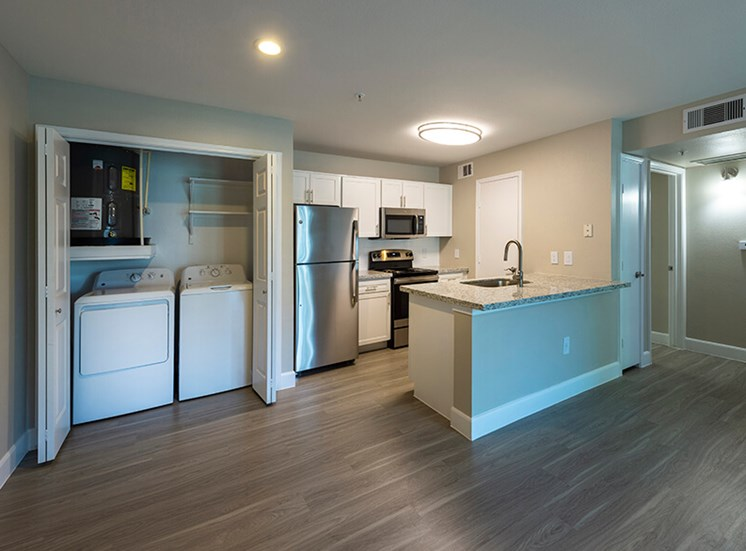 apartment washer/dryer and kitchen at 8181 Med Center, Houston, 77054