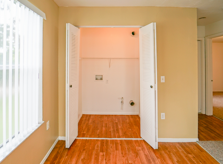 Large reach-in closet with hardwood style flooring