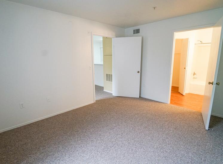 Bedroom with carpet flooring and en-suite bathroom