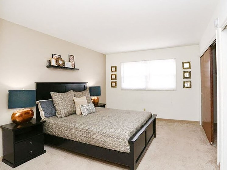 bedroom with large closet at Town & Country apartments
