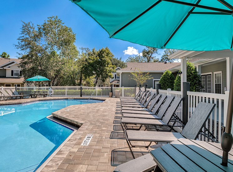 Relaxing Pool And Outdoor Entertainment Area