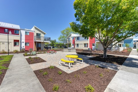 Outdoor Lounge Space Walking Path, Wood Chip Floor, Picnic Tables
