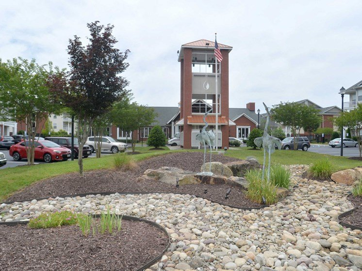 beautifully landscaped entrance to 1200 Acqua Luxury Lifestyle Apartments in Petersburg Virginia near Fort Lee