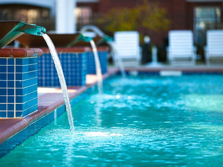 water features pour into the pool at 1200 Acqua