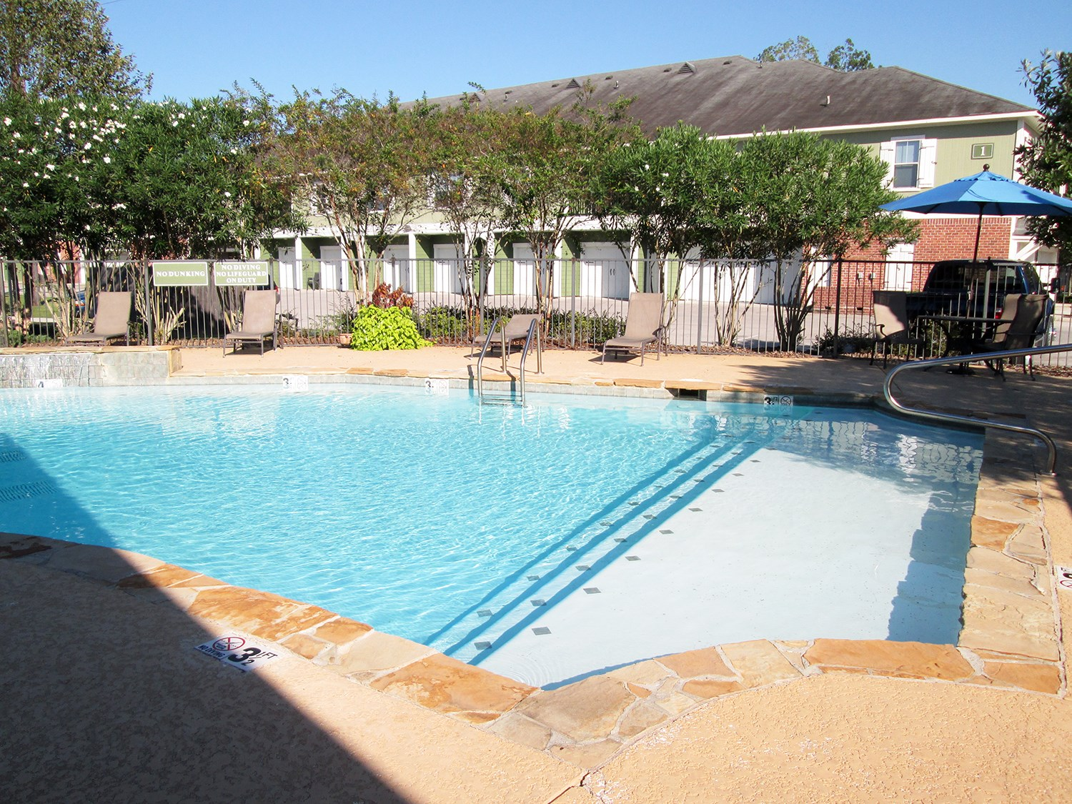 Swimming Pool at Highlands of Grand Pointe Apartments in Lafayette, LA