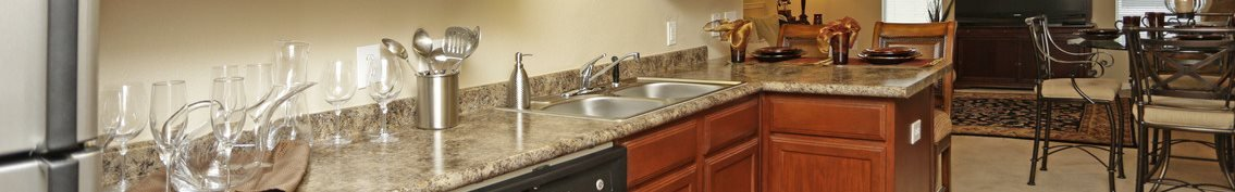 Kitchen at Highlands of Grand Pointe Apartments in Lafayette, LA