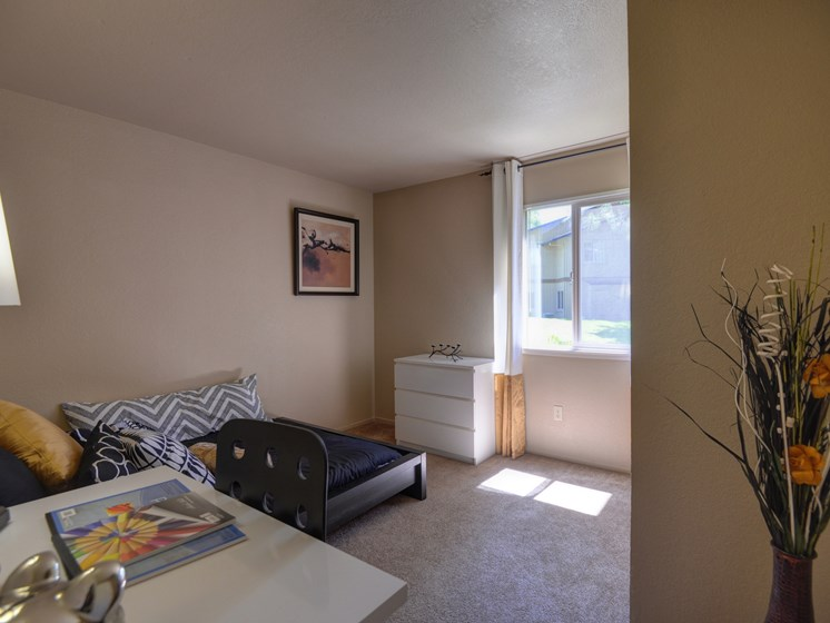 Bedroom with Open Window, Twin Sized Mattress, Desk and Carpet