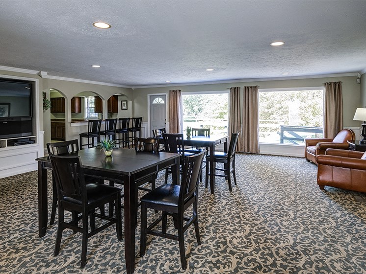Clubhouse with seating and entertainment center.