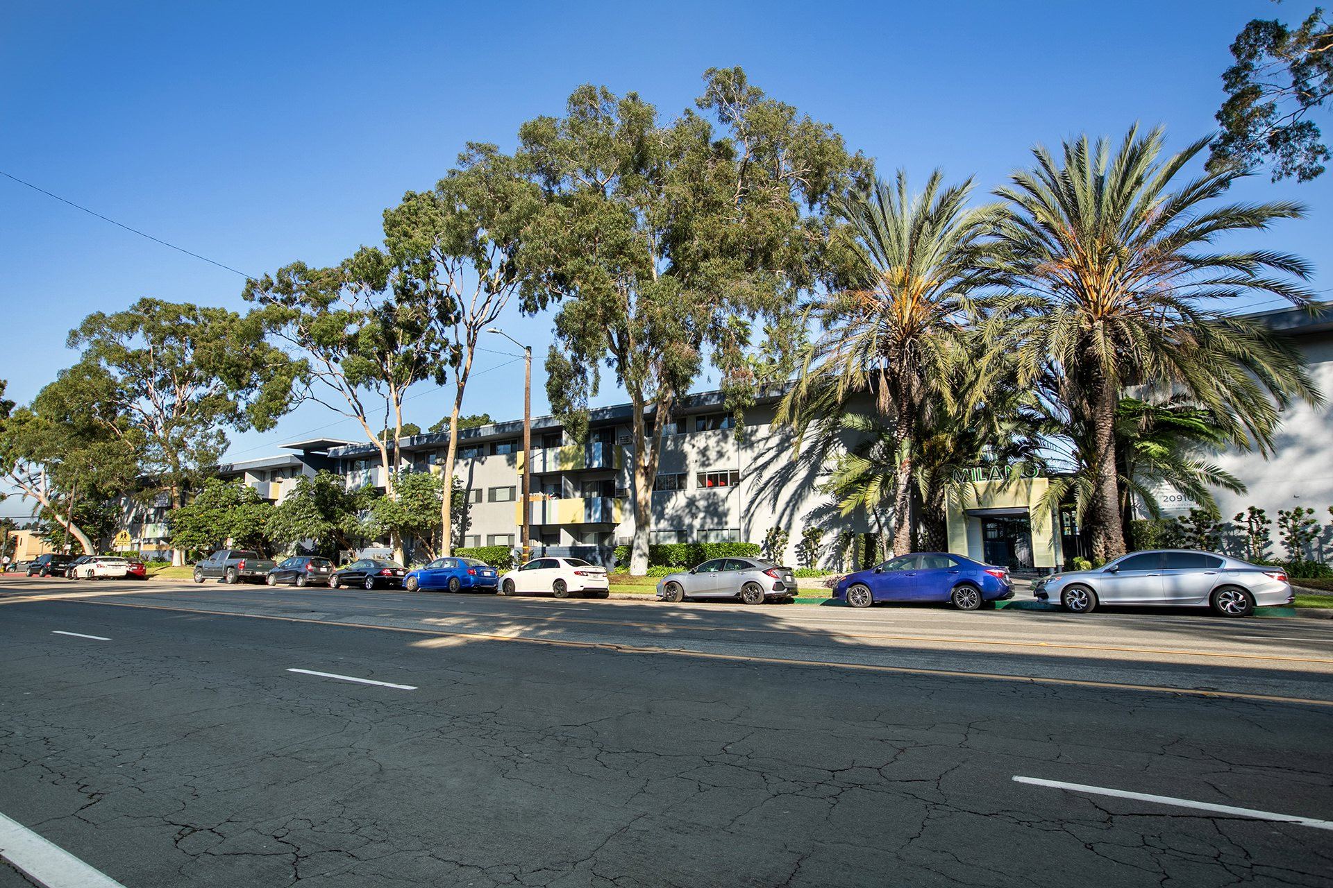 Torrance, CA Apartments - Exterior View of Milano Apartment Building Surrounded By Lush Landscaping