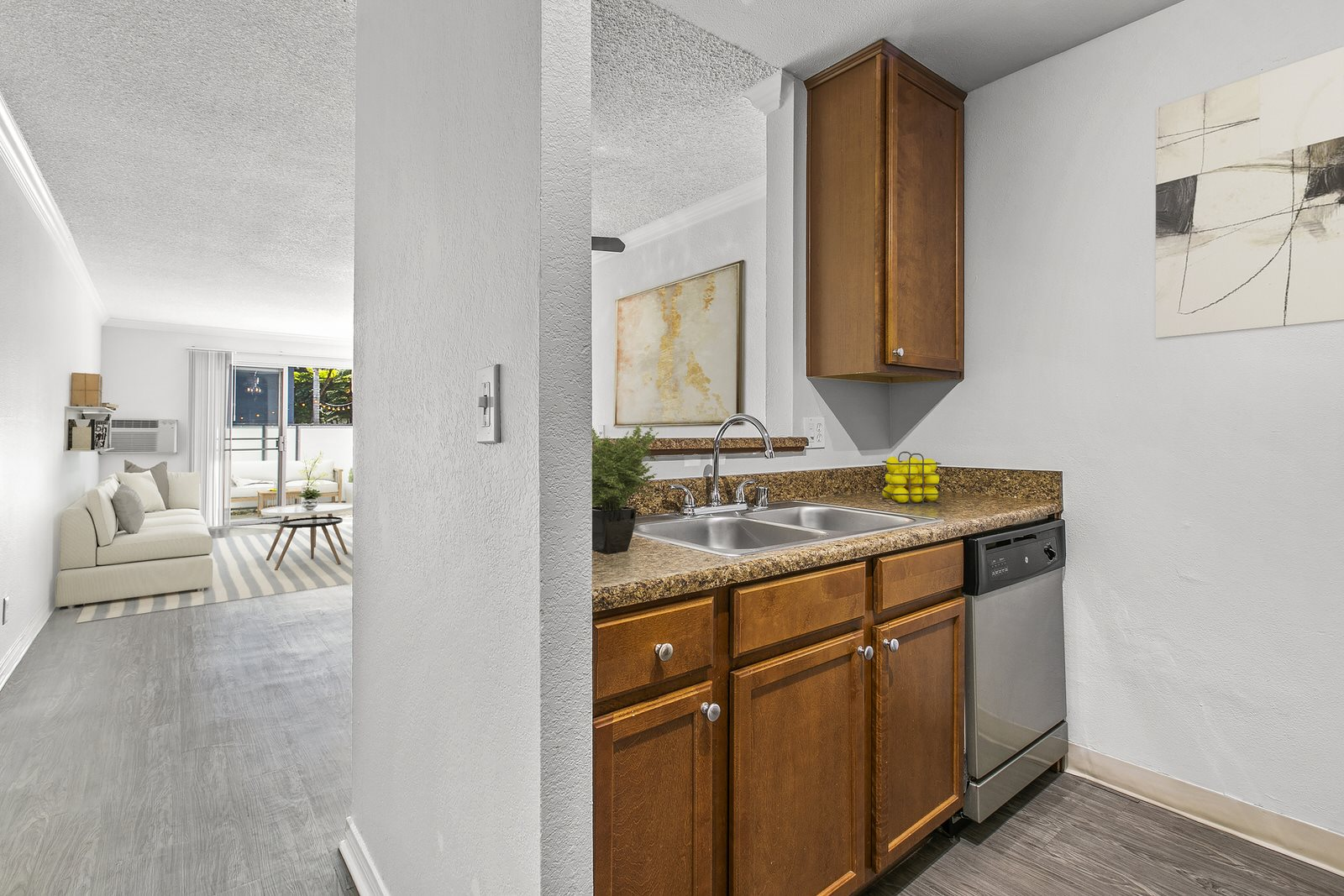 Living Area and Kitchen Interior Photo at Milano Apartments 20900 Anza Ave Torrance, CA 90503