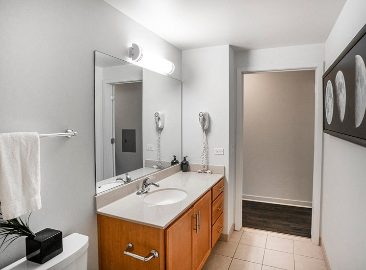 Alta at K Station's guest apartment features a bathroom with ample counter space