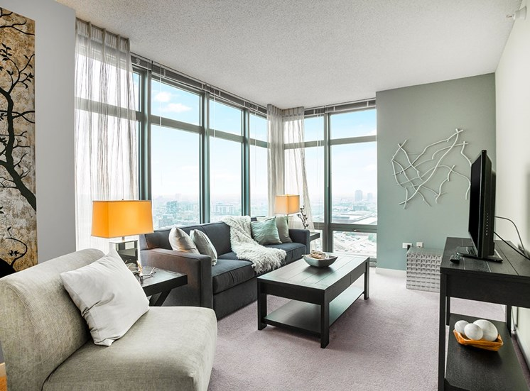 Alta at K Station's spacious apartment living areas feature sweeping views of Chicago