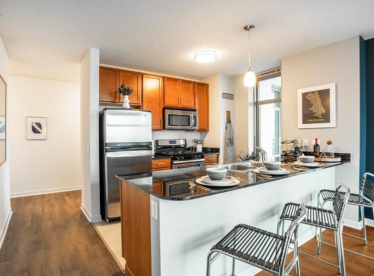 Alta's apartment kitchens feature stainless steel appliances and breakfast bars