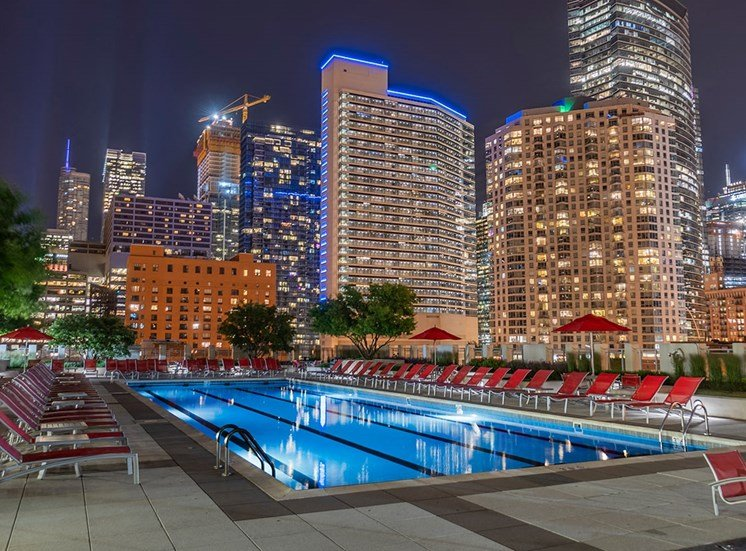 Views of the Chicago skyline at night from Alta's rooftop terrace