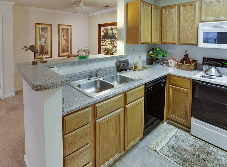 Governors Gate apartment model suite kitchen in Pensacola, Florida