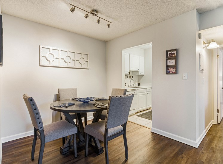 Woodcliff model suite dining area in Pensacola, Florida
