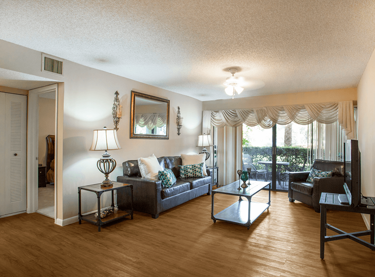 Village Crossing apartment model suite living area in West Palm Beach, Florida