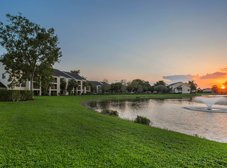 Village Crossing apartments lakeside sunset in West Palm Beach, Florida
