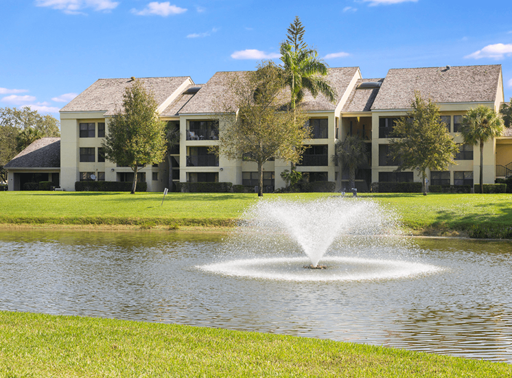 Village Crossing apartments with a lake view in West Palm Beach, Florida