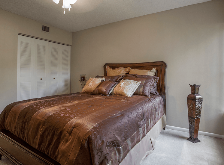 Village Crossing apartment model suite bedroom in West Palm Beach, Florida