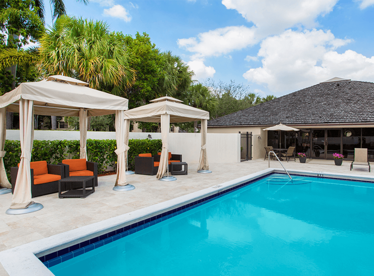 Village Crossing apartments poolside cabanas in West Palm Beach, Florida