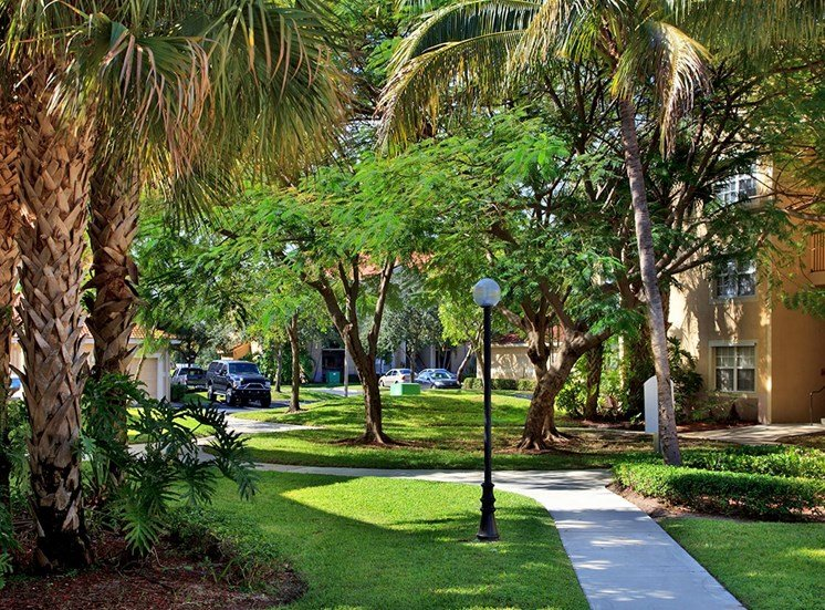 Woodbine apartments tropical landscaping in Riviera Beach, Florida