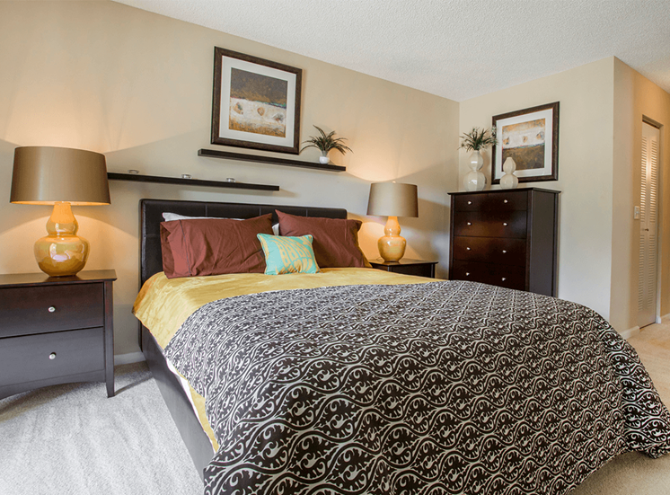 Blue Isle model suite bedroom in Coconut Creek, Florida