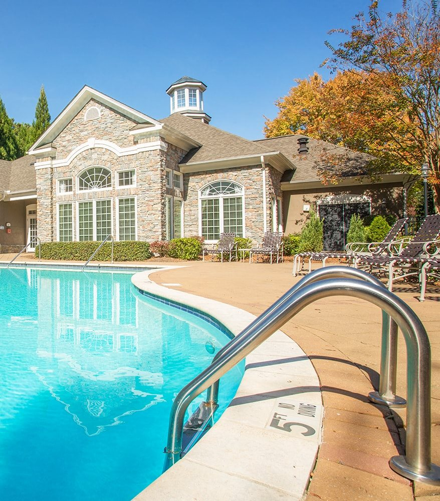 Barrett Walk Apartments in Kennesaw features a beautiful pool and patio area