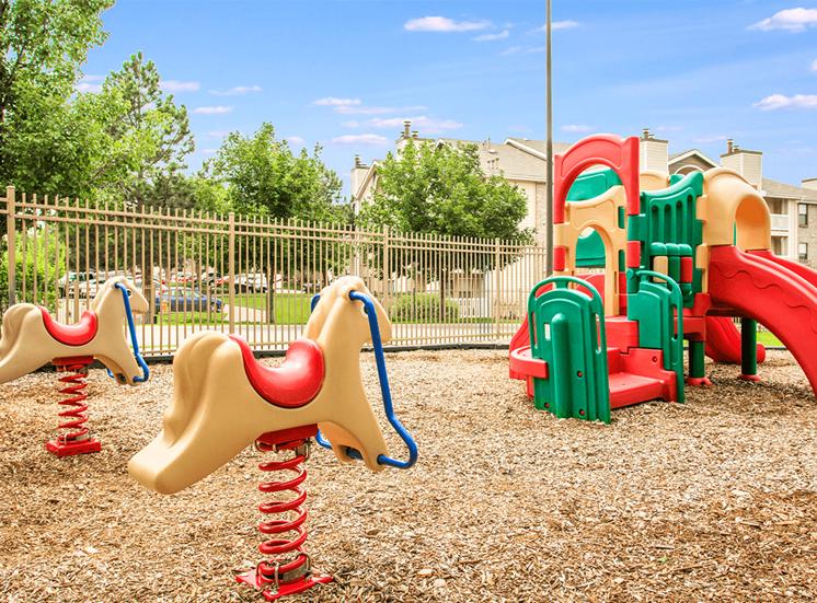 Retreat at City Center apartments fenced playground in Aurora, Colorado