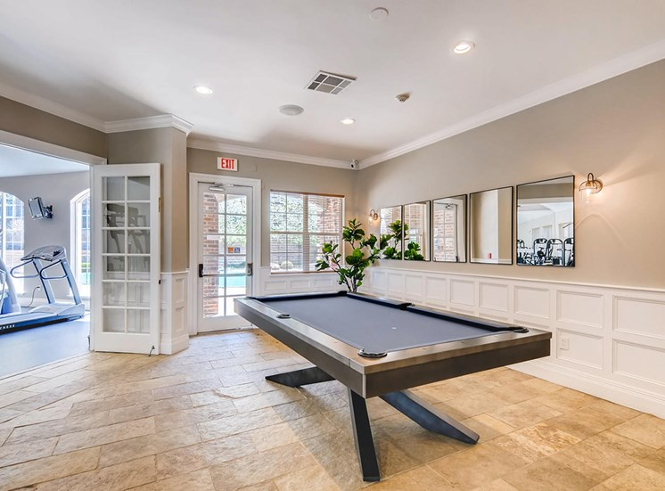 Retreat at City Center apartments clubhouse with billiards table