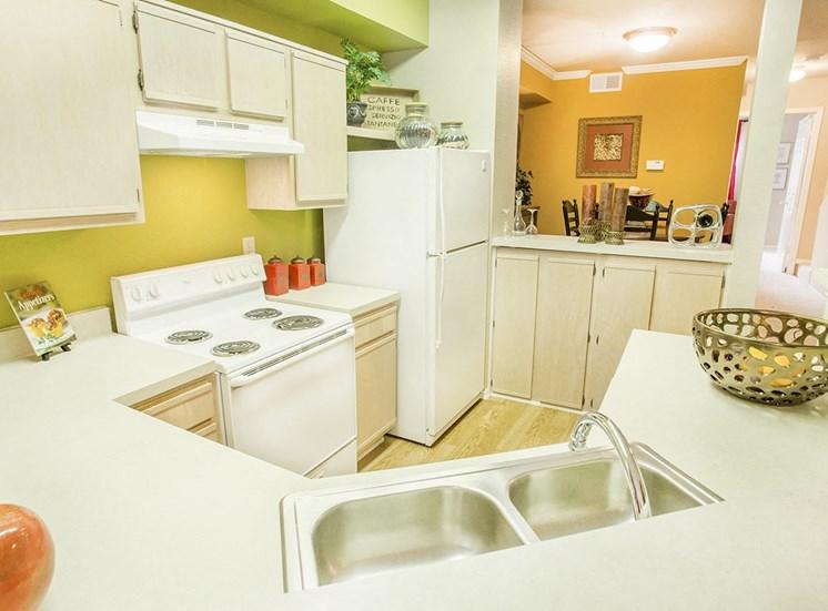 Retreat at Spring Park model suite kitchen in Garland, TX