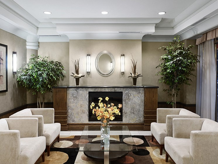 Apartment Lobby with Couches and Flower Centerpiece