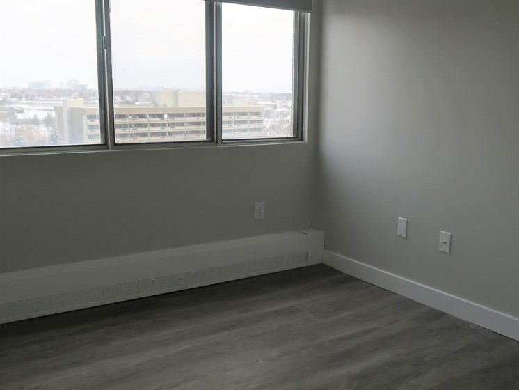 Renovated Bedroom With Grey Laminate Floors