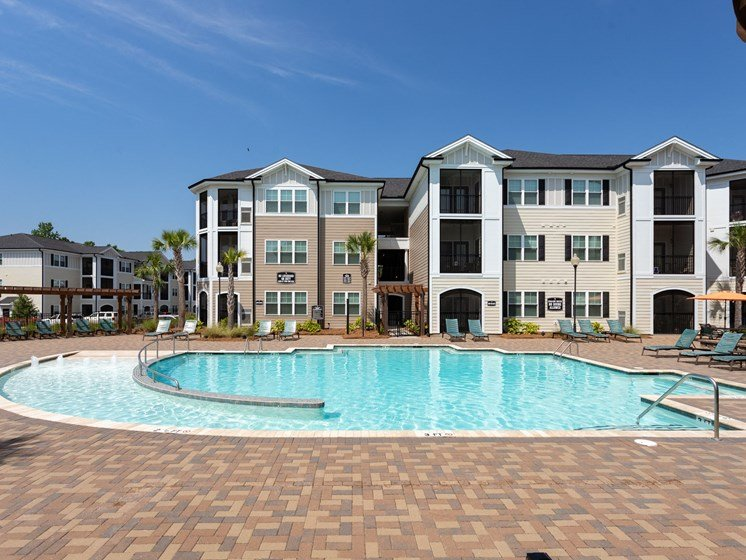 Relaxing Area by the Pool at Abberly Crossing Apartment Homes by HHHunt, Ladson