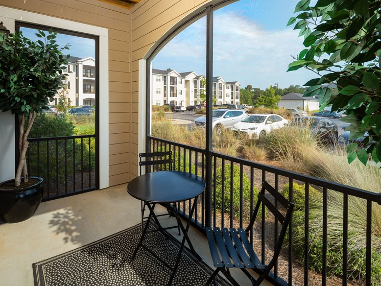 Private Balcony With Seating at Abberly Crossing Apartment Homes by HHHunt, Ladson, 29456