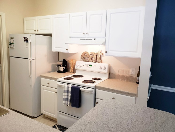 White-on-White Kitchen Design at Abberly Grove Apartment Homes by HHHunt, North Carolina