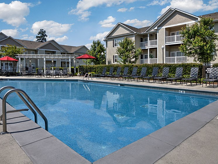 Splash in the pool at Abberly Grove Apartment Homes by HHHunt, Raleigh, NC 27610