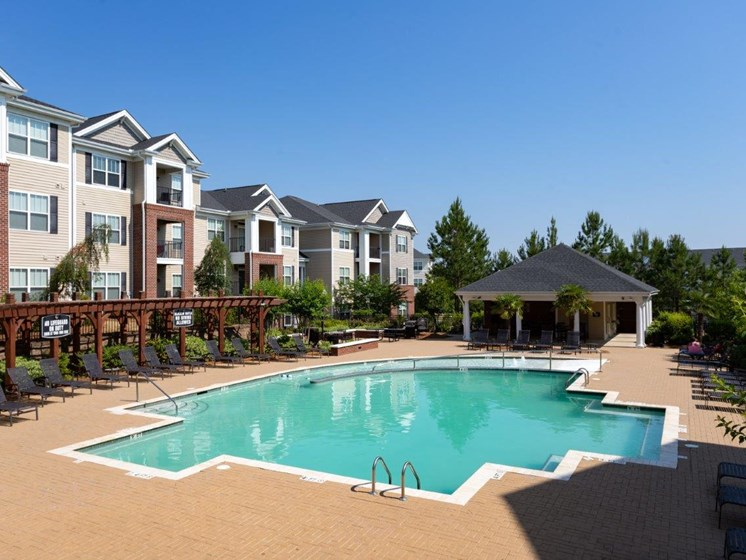 Swimming Pool With Relaxing Sundecks at Abberly Village Apartment Homes by HHHunt, West Columbia