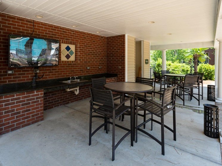 Shaded Outside Sitting Area at Abberly Village Apartment Homes by HHHunt, West Columbia, SC, 29169