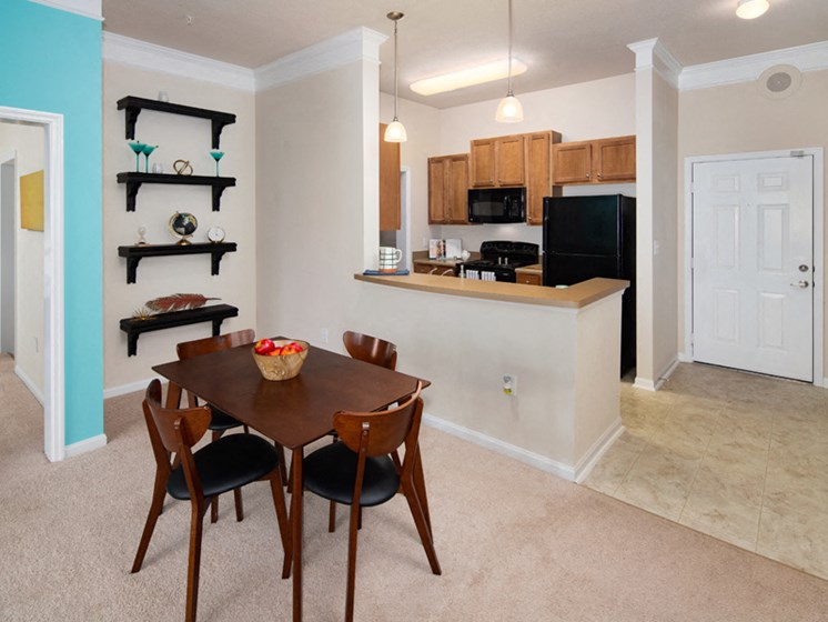 Gourmet Kitchens And Dining Table at Abberly at West Ashley Apartment Homes by HHHunt, South Carolina, 29414