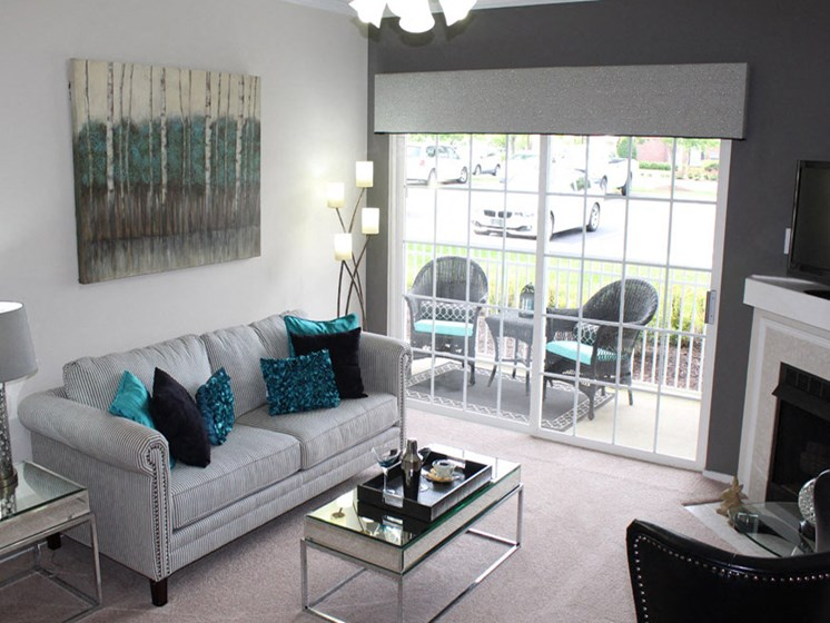 Large Living Room With Private Balcony at Abberly Twin Hickory Apartment Homes by HHHunt, Glen Allen, 23059