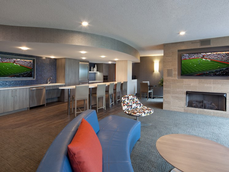 Resident Social lounge with flatscreen television and kitchen with seating